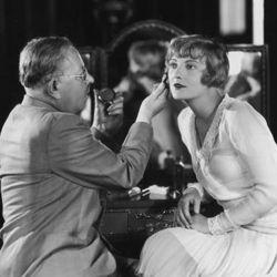 Max Factor advises actress Dorothy Mackaill on her makeup, circa 1930.