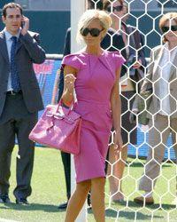 Victoria Beckham shows off her posh Hermes Birkin.
