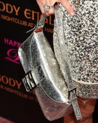 Paris Hilton sports a glittery Fendi bag to match her glittering dress at her 2009 birthday party.