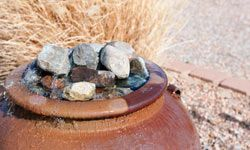 Water features like this small fountain add a sense of sound and serenity.