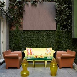 Treating an outdoor porch or patio like a living room can create spaces better suited for socializing.