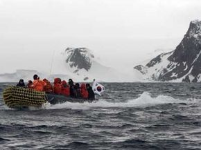 A boat transports U. N. delegates from South Korea to Antarctica in November 2007. The visit came in response to challenges to the 1959 treaty aimed at staving off territorial claims on the continent.