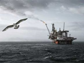 Oil rigs currently can reach about 10,000 feet (3,048 meters) into the ocean. To what depths will future platforms sink?