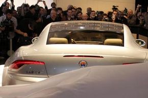 The Fisker Karma, one of the few luxury plug-in hybrid cars, could get more than 100 miles per gallon (42.5 kilometers per liter).