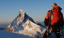 A climber views the Matterhorn from a distance.