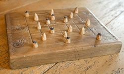 You can use a dedicated board, like this one, to play Nine Men's Morris, or you can just sketch out a simple diagram.