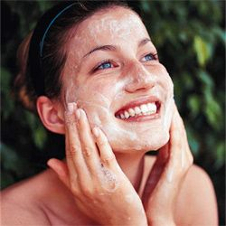 People with sensitive skin may avoid lathering up their face like this squeaky clean woman and opt for water instead. See pictures of makeup tips.