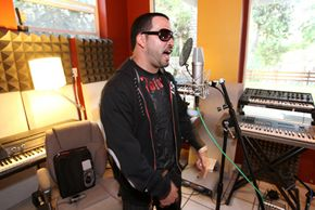 Microphones liked this one used by Latin hip-hop artist Malverde are essential for recording.