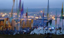 Dawn rises over the festival site during day three of the Glastonbury Festival in June 2008.
