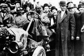 The first transcontinental car race from New York to Seattle was held in 1909 — Henry Ford's Model T won. The trip took 22 days and 55 minutes at an average speed of just 7.75 mph. (Henry Ford is shown standing next to the car.)