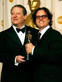 """Former Vice President Al Gore poses with director Davis Guggenheim after winning an Academy Award for their 2006 documentary """"An Inconvenient Truth."""" In 1999, Gore came under fire for reportedly overstating his role in the creation of the Internet."""