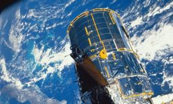 The Hubble Space Telescope positioned over the Earth
