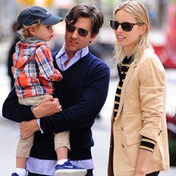 On the street in Soho: Film producer Archie Drury and model Karolina Kurkova, wearing a Soho staple, the tailored jacket