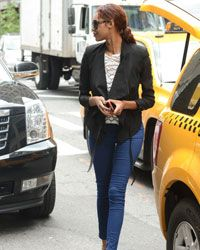 On the street in Soho: Model Jessica White in skinny jeans and a classic, tailored black jacket.