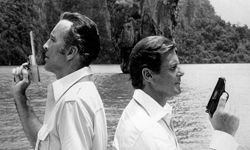 """British actor Christopher Lee, left, who plays villain Francisco Scaramanga, and British actor Roger Moore, as James Bond, film a scene of Ian Flemming's """"The Man with the Golden Gun,"""" on location at Phang Nga, Thailand, Aug. 15, 1974."""