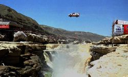 Obviously, this is not Kenny Powers jumping the St. Lawrence River in his 1976 Lincoln Continental. It's Taiwanese stuntman Ke Shouliang jumping a Mitsubishi across the Yellow River at China's Shaanxi province in north China.