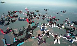 Some eighty-eight skydivers from Skydiving the Point, a Virginia skydiving club, are shown over West Point, Va., on Oct. 23, 1997.