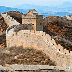 You can take a cycling day trip along the Great Wall of China for a scenic view of an amazing historical landmark.