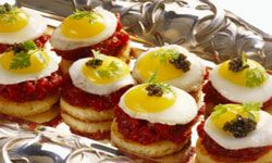 Fried quail eggs on steak tartare might be a little too sophisticated for your crowd. See more pictures of holiday noshes.