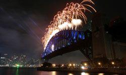 Fireworks shoot from the Sydney Harbor Bridge.