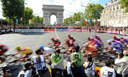 This image from the 2011 Tour de France uses motion blur to capture the speed and excitement of the final stage of the race.