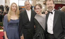 Jobs, pictured here with his wife and Disney/Pixar's Ed Catmull and Catmull's daughter at the 79th Annual Academy Awards, traded his mock-neck and jeans combo for a stylish tuxedo at the Kodak Theatre on Feb. 25, 2007 in Hollywood, Calif.