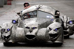 """Image Gallery: Exotic Cars Artist William Burge sits in his art-car """"Phantoms"""" at a presentation prior the Essen-Motor-Show 2007 in the city of Essen, Germany, on Nov. 26, 2007. See more pictures of exotic cars."""