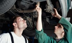 The O2 sensor typically screws into the vehicle's exhaust system, either in the exhaust manifold or a pipe downstream.