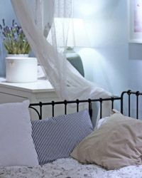 Light shades of blue can have a soothing effect and are perfect in a bedroom.