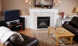Dark furniture can bring extra warmth to a room with light brown walls.