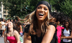 While she's participating in a dance flash mob in this picture, model Tyra Banks shows similar enthusiasm for petroleum jelly. See more pictures of beautiful skin.