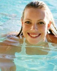 Swimming a few laps in the pool may be fun, but it's not good for your tooth enamel.