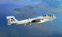 An EA-6B Prowler from the Salty Dogs of Air Test and Evaluation Squadron 23 flies over Southern Maryland. The plane uses a biofuel blend of JP-5 aviation fuel and camelina oil. The Prowler successfully completed its inaugural biofuel flight.
