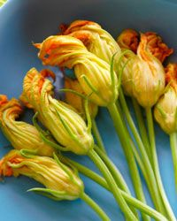 Trim the stems of zucchini flowers to about half an inch before cooking.