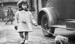Taking your cat for a stroll didn't necessarily go out of fashion in the 1930s.