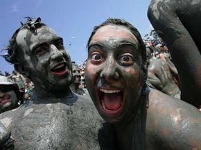 Participants enjoy the mud fiesta at the Boryeong Mud Festival on July 12, 2008.