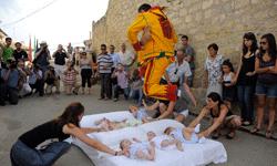 El Colacho clears a mattress full of babies.