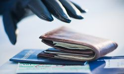 If you keep your wits about you, you'll slap away this gloved hand when it gets near your passport. See more pictures of money scams.