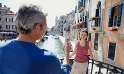 While you steal a shot of your wife in Venice, a pickpocket could be stealing your wallet.