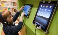 A young boy tries out kids' games on Apple iPads at the 2011 Leipzig Book Fair in Leipzig, Germany.