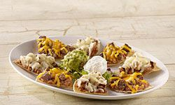 Nachos are best piled high with beans and cheese.