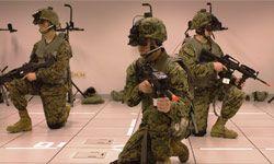 Marines at Camp Lejune, N.C., walk through a virtual ground combat scenario using FITE.