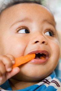 Baby teeth arrive during this developmental stage and your baby can now feed himself or herself.