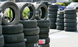 New tires are displayed outside of a tire shop in San Jose, Calif.