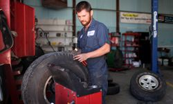 Merle King works on balancing a tire at Bagsby Tractor and Truck repair shop in Spring Hill, Tenn.