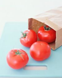 All you need turn green tomatoes red is a standard brown paper bag. It's important to make sure they're not touching, however.