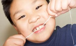 Kids should start flossing as soon as their teeth begin touching one another -- even baby teeth.
