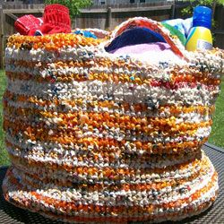 This bag, woven from plarn, is a great tote to take to the beach. Sunscreen spills and sand wipe right off!
