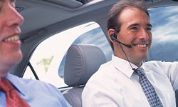 It's common now for cars to offer hands-free Bluetooth integration, so you can talk on the phone while still keeping both hands on the wheel.