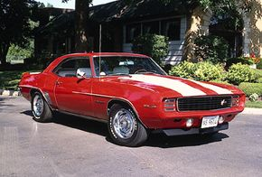 A cowl-induction hood was standard on the 1969 Chevrolet Camaro Z28. The available Rally Sport package concealed the headlights behind hinged doors. See more classic muscle cars pictures.